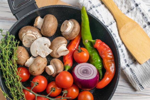Fresh organic ingredients in frying pan