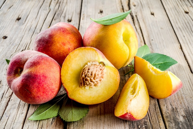 Fresh organic peaches  on rustic wooden table
