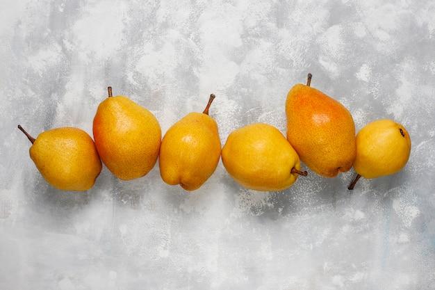 Fresh organic pears on light