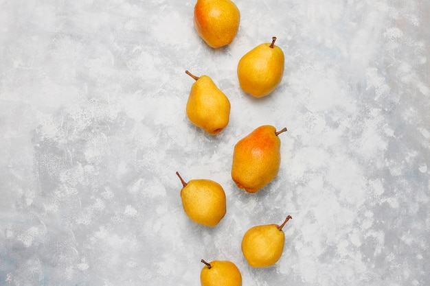 Fresh organic pears on white grey concrete . selective focus.