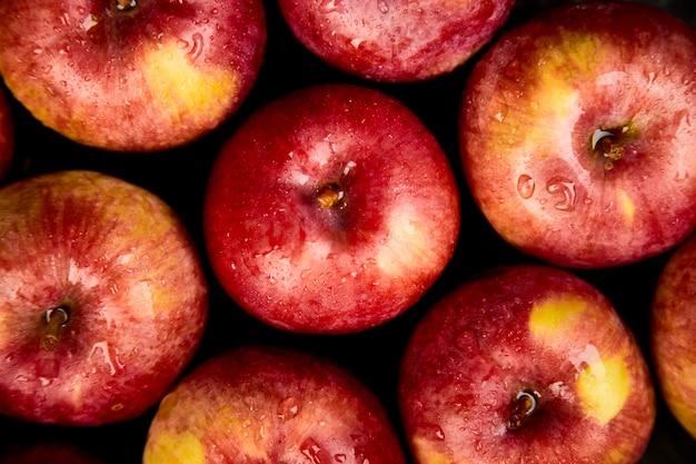 Fresh organic red apples on black.