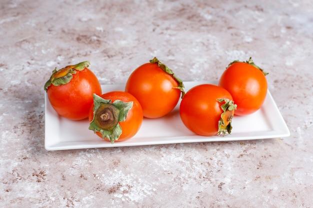 Fresh organic ripe persimmon fruits.