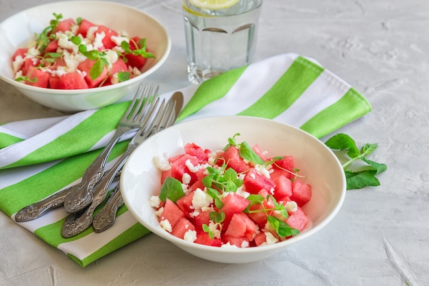 Fresh organic salad with watermelon, feta cheese and mint