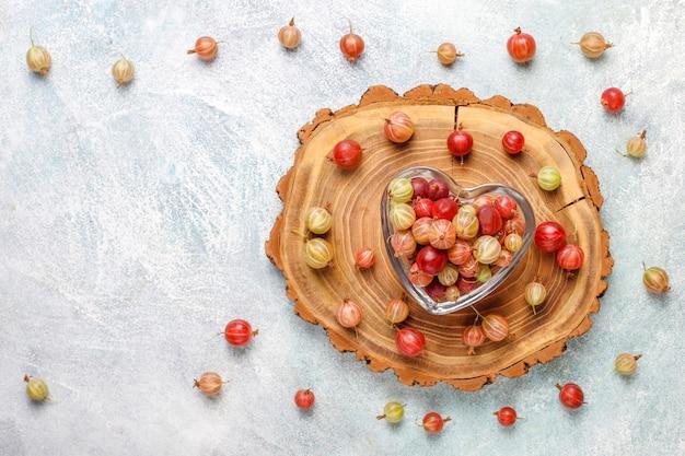 Fresh organic sweet gooseberries in bowl