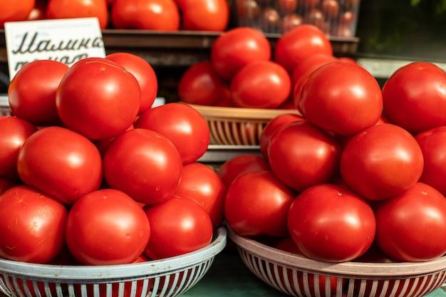 Fresh organic tomatoes in baskets.