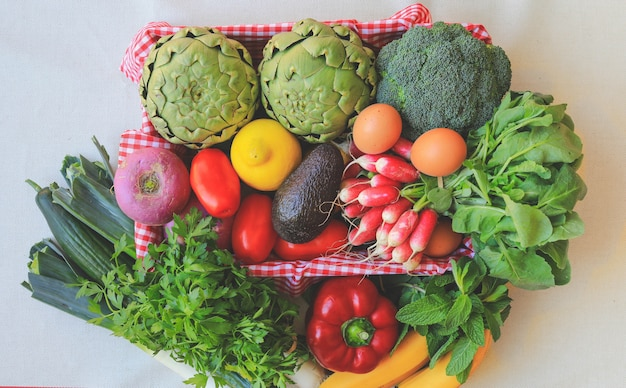 Fresh organic vegetables in basket, eco friendly shop.