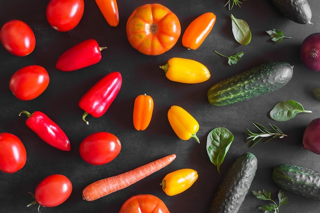 Fresh organic vegetables on a dark background. top view