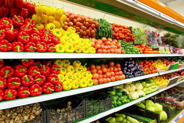 Fresh organic vegetables and fruits on shelf in supermarket, farmers market. healthy food concept. vitamins and minerals. tomatoes, capsicum, cucumbers, mushrooms, zucchini