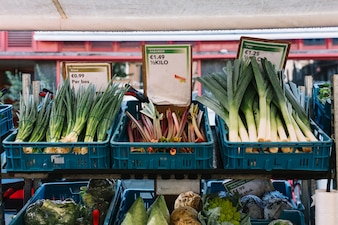 Fresh organic vegetables in the crate at market stall