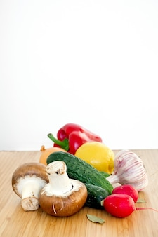 Fresh organic vegetables mushrooms on wooden table background banner copy space.