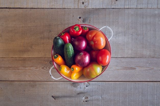 Fresh organic vegetables on a rustic wooden table. top view