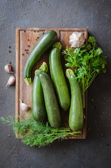 Fresh organic zucchini, garlic and parsley, herbs and spices.