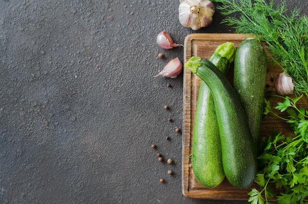 Fresh organic zucchinis, garlics and parsley