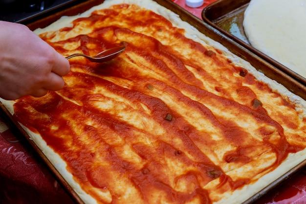 Fresh original italian raw pizza, preparation traditional style.