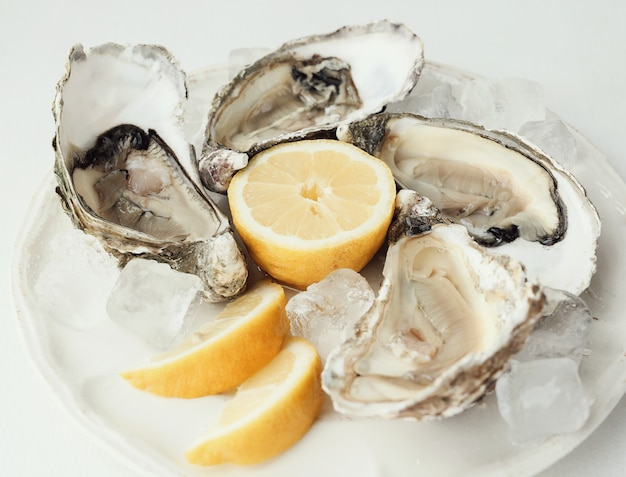 Fresh oyster with lemon on a plate