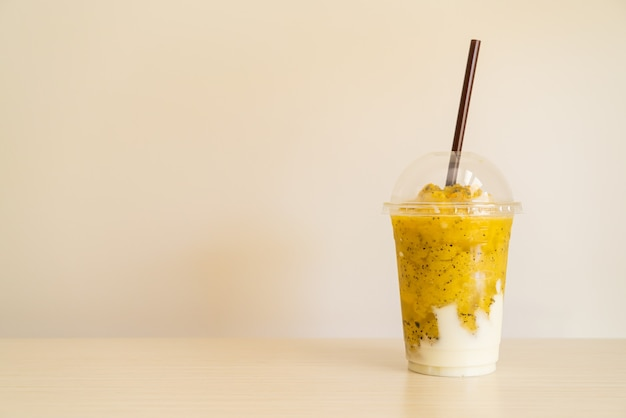 Fresh passion fruit smoothies with yogurt in glass