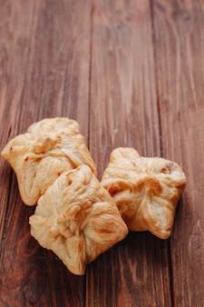 Fresh pastry on a wooden background