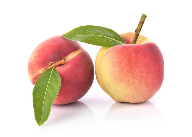 Fresh peaches fruit on white background