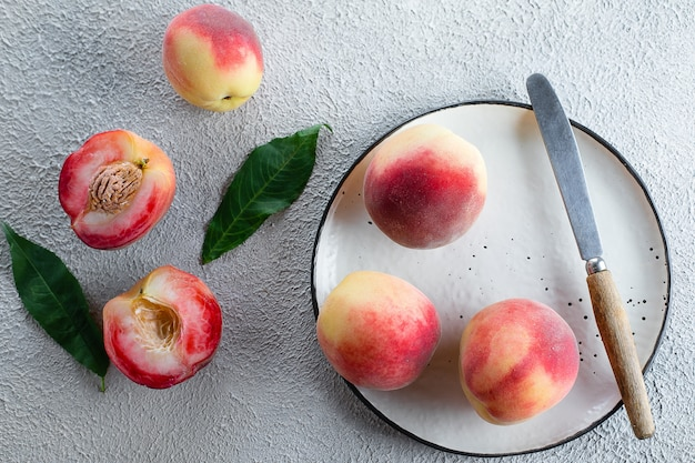 Fresh peaches. peaches on light concrete