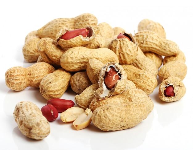 Fresh peanuts on white