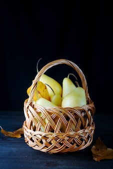Fresh pears in a wicker basket
