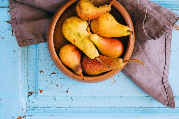 Fresh pears in a wooden plate