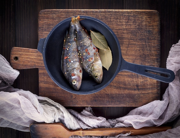 Fresh peeled fish from scales with spices