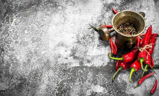 Fresh pepper in a mortar on a rustic background