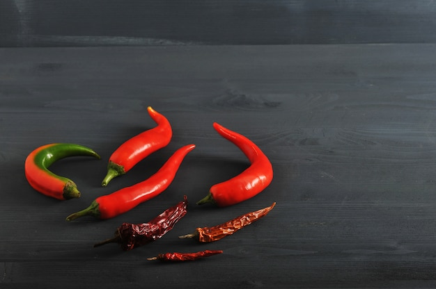 Fresh peppers and dried pods of chili peppers