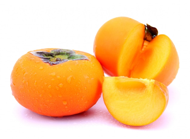 Fresh  persimmons isolated on white background.