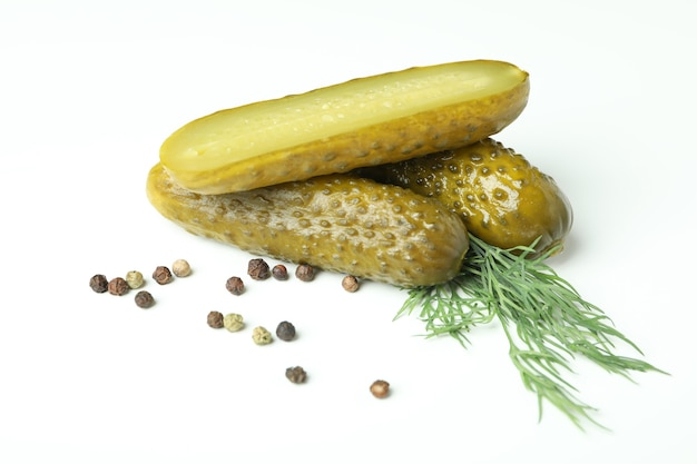 Fresh pickles and spices on white background