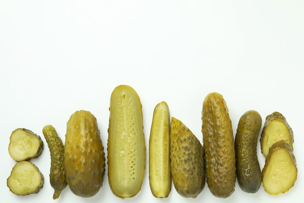 Fresh pickles on white background, top view