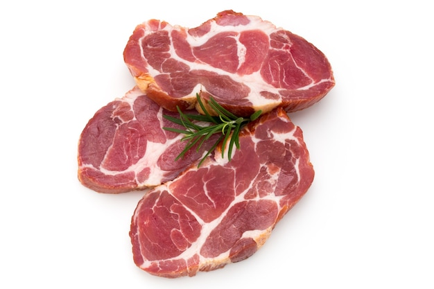 Fresh pig meat stake isolated on white