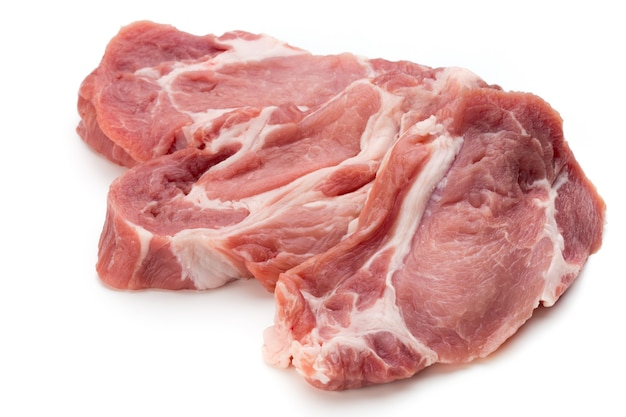 Fresh pig pork slices isolated on the white surface.