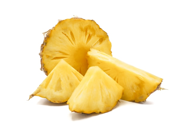 Fresh pineapple fruit with slices on white background