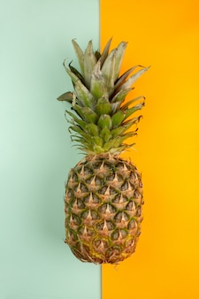 Fresh pineapple on a ice blue and orange background