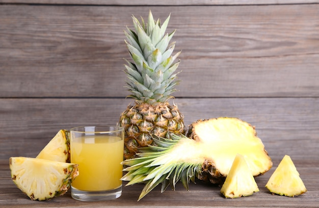 Fresh pineapple juice in the glass with slices