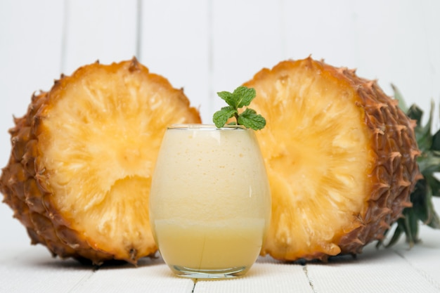 Fresh pineapple juice isolated on a white background.