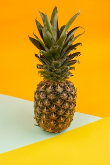 Fresh pineapple juicy mellow ripe vitamine riched on a white tissue and orange