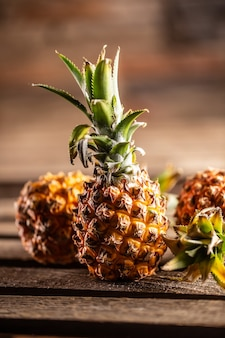Fresh pineapples served on a vntage board.