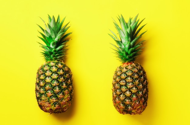 Fresh pineapples on yellow