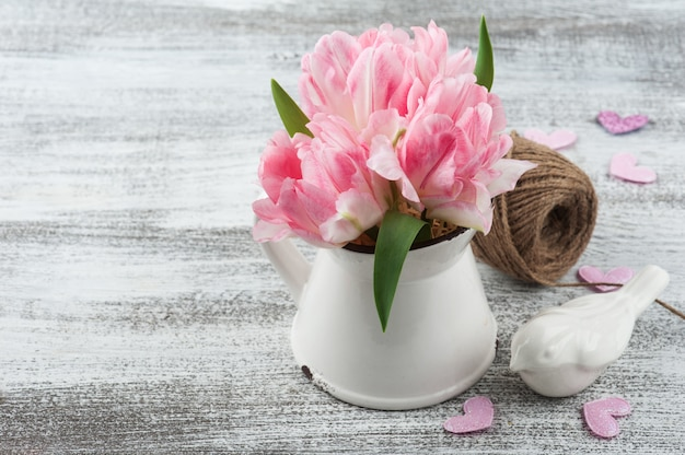 Fresh pink tulip flowers in jug