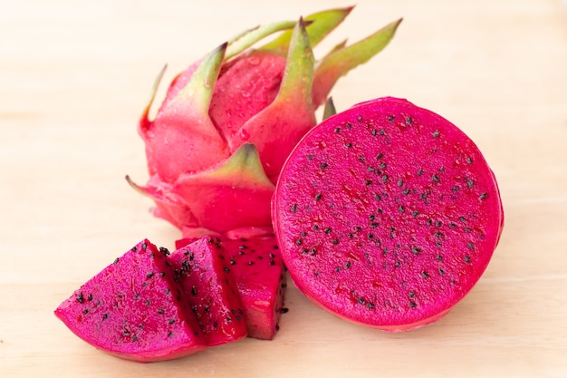 Fresh pitahaya fruit sliced on wooden background .
