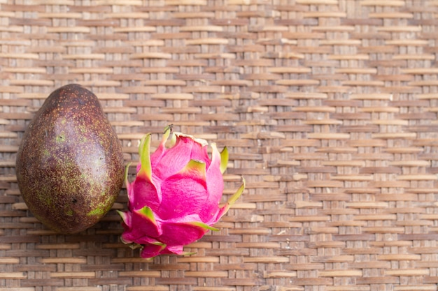 Fresh pitahaya fruit on wood