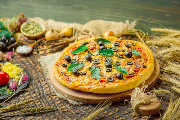 Fresh pizza with tomato and mushrooms