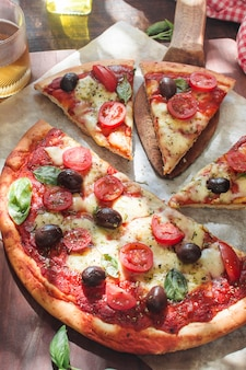 Fresh pizza with tomatoes; cheese and mushrooms