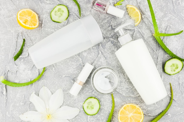 Fresh plants scattered with body care products