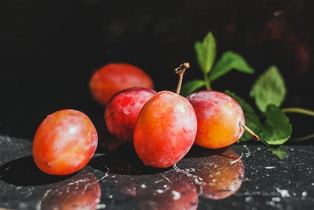 Fresh plum on a black background