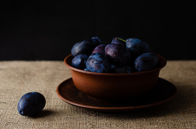 Fresh plums on a bowl