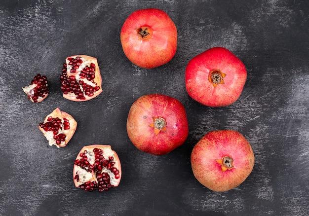 Fresh pomegranate top view on dark